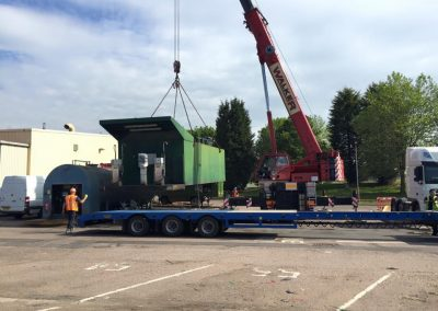 Tank being loaded onto lorry for DHL
